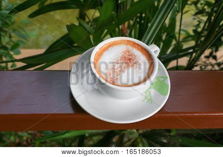 close up coffee cappuccino on wooden balcony