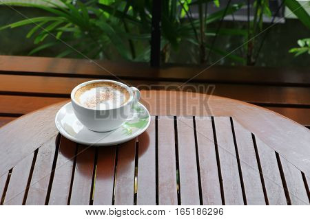 coffee cappuccino on the wood floor background