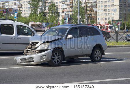 SAINT PETERSBURG, RUSSIA - JUNE 08, 2015: Broken car standing in the middle of the roadway