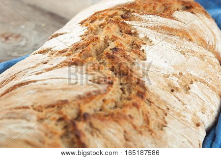 wholegrain fresh homamade bread on wooden roostick background