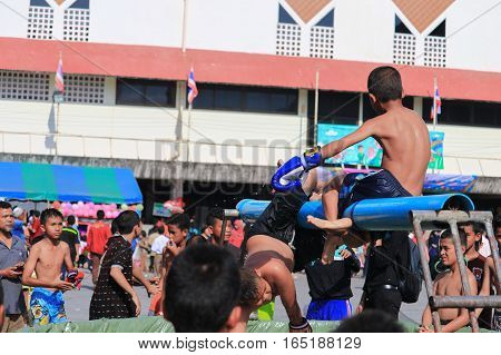 YalaTHAILAND - JANUARY 14 2017 : Traditional water Thai boxing (or Muay Talay) - ancient Thai fight above the water in Children's Day Festival . southern Yala. Thailand