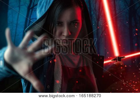 The angry girl pulled the hand forward, beam weapons, Laser swords. dark forest