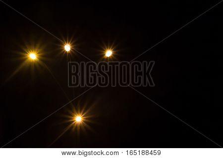 Bright lights on a dark background. Blurring on a dark background.