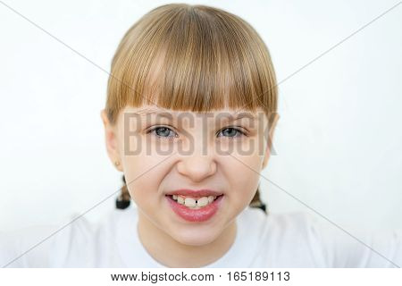 Portrait of young teenager girl emotional posing on white background isolated. angry, evil