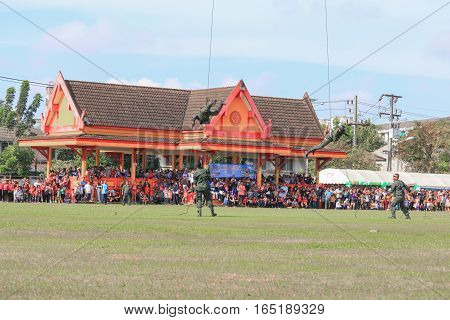 YalaTHAILAND - JANUARY 14 2017 : Soldiers rappelling from helicopter in Festival Children's Day. Southern Yala. Thailand