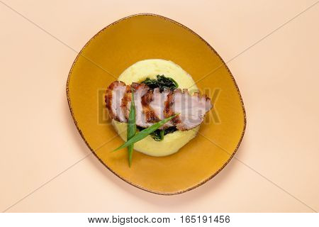 Sliced meat with mashed potatoes on light background
