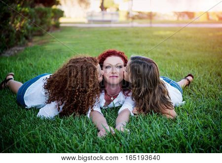 Happy young mother with daughter resting outdoors
