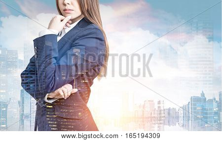 Close up of a businesswoman with long hair wearing a suit. There is a city panorama in the foreground. Toned image. Mock up. Double exposure