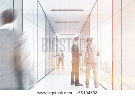 People in a long office corridor with glass walls. There are several conference rooms in it and. Concept of a successful company. 3d rendering. Toned image. Double exposure