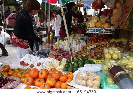 Street Vendor Selling Fruits On Wet Market In Macau.