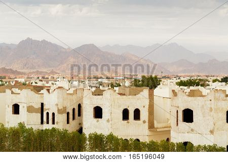 City landscape with low-grade houses in Egypt against mountains