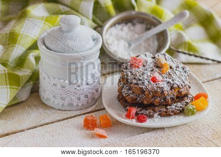 Cookies On The Plate With Sugar Powder And Candied Peels