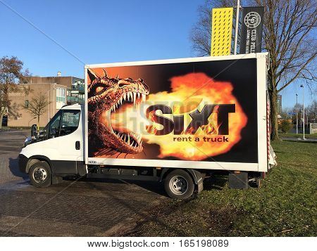 Almere, The Netherlands - Januari 14, 2017: Sixt rental truck, parked by on a public parking spot in the city of Almere. Nobody in the vehicle.