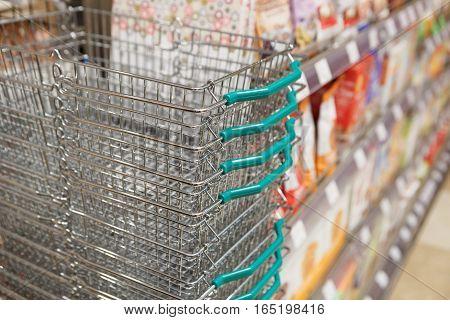 Row Of Empty Metal Shopping Basket
