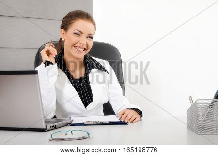 Young busness woman with computer. Business concept
