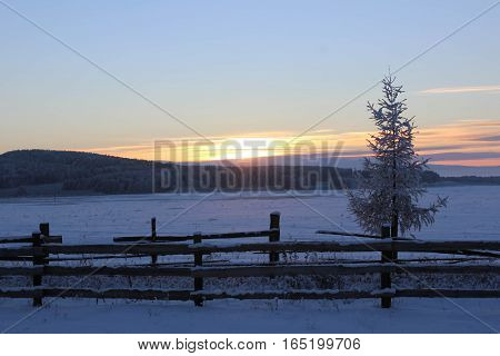 Beautiful sunset in the snowy valley in winter