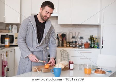 Cheerful Man Preparing An Healthy Breakfast In The Morning