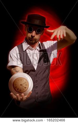 Bearded man in hat holding sphere with clock