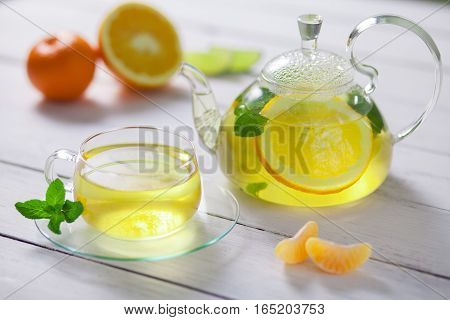 A beautiful composition of green tea and the addition of citrus