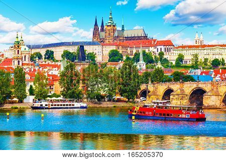 Scenic summer panorama of the Old Town architecture with Vltava river, Charles Bridge and St.Vitus Cathedral in Prague, Czech Republic