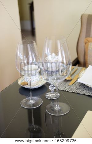 Wine glass on table at restaurant. Tables set for meal
