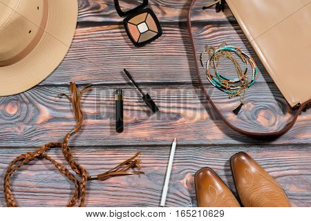 Bag stuff and accessories in a traditional american cowboy style on a wooden background