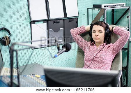 A Radio Dj Announces News In A Radio-studio