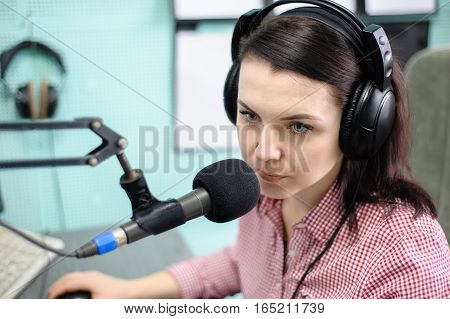 A Radio Dj Announces News In A Radio-studio