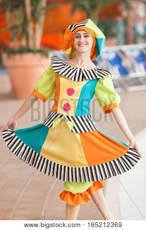 the beautiful girl in a suit of the clown. The girl the animator on a children's holiday.