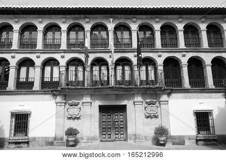 Ronda (Andalucia Spain): facade of the Ayuntamiento historic town hall. Black and white