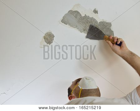Man Scratching A Ceiling