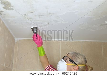 Woman Peeling A Ceiling