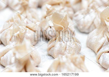 Homemade fresh wonton dumplings. Close up photo.