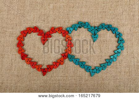 Two Hearts Shaped Of Sewing Buttons On Canvas
