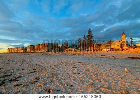 People watching beautiful sunset at Glenelg Beach South Australia