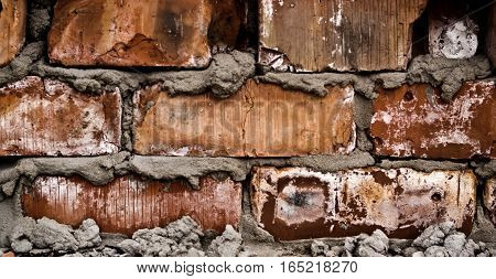 The image is poorly done brickwork. Bad work. Close up of badly bricks. Brick wall. Grunge brick wall.