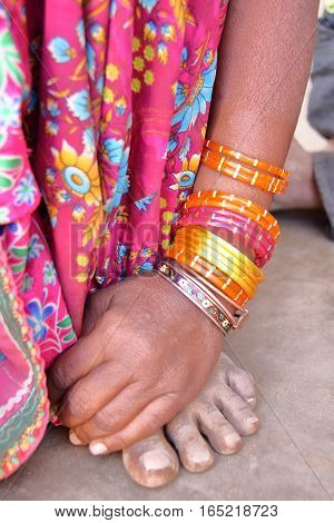 NIRONA, GUJARAT, INDIA: detail of colorful bracelet and sari in Nirona, local village near Bhuj
