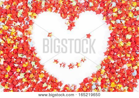 red star paper heart shape smile face on white background