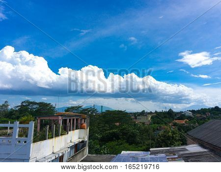 White cloudy sky view from rooftop's house photo taken in Jakarta Indonesia java
