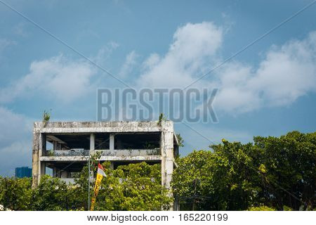 Abandoned office building with trees and cloudysky photo taken in Jakarta Indonesia java