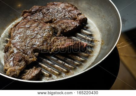 Grilling Steak On Grill Pan. Beefsteak Cooking On A Kitchen. Fresh, Delicious, Spicy, Juicy Meat Wit