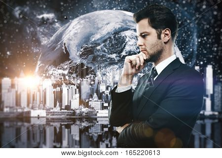 Side portrait of handsome young businessman on abstract city in space background. Research concept.