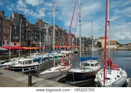 Yachts Moored At Quay Port Of Honfleur, France. Concepts Of Success, Leisure, Holiday, Rich, Tourism
