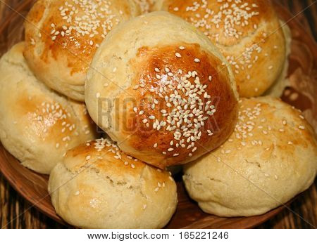 Fresh homemade bread rolls with sesam seed on table