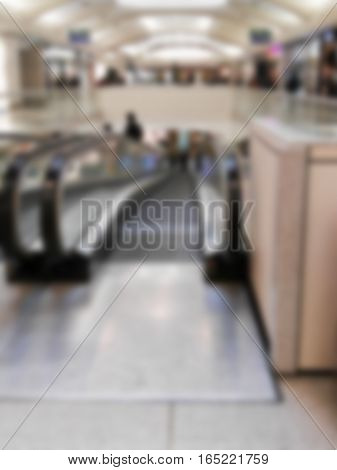 escalators of a shopping center blurry for internal backgrounds