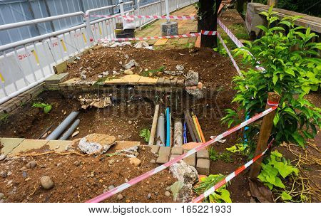 Digging a hole with optic cable inside for constructing pedestrian photo taken in Jakarta Indonesia java