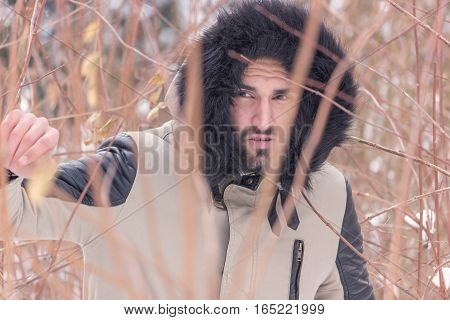 Young Man Behind Branches Struggle