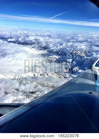 flying in fluffy white clouds on a clear blue day