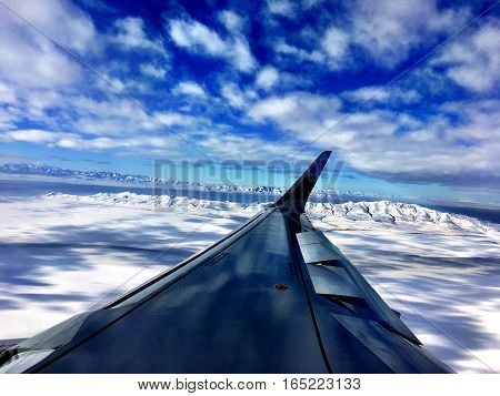 airplane wing flies over winter Salt Lake City