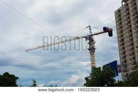 A crane and a building photo taken in Jakarta Indonesia java